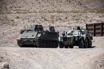 Tank and armoured vehicle stationed in the desert