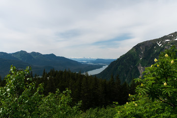 Mountaintop overlooking channel and mountain range in distance