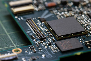 Electronics background technology close up of the green kit circuit board. Application Specific Integrated Circuit..