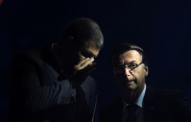 Presidential candidate Jair Bolsonaro of the Party for Socialism and Liberation (PSL) listens to his assessors before their first television debate at the Bandeirantes TV studio in Sao Paulo, Brazil