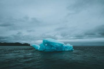 Ominous Iceberg in Dark Stormy Water