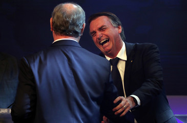 Presidential candidate Jair Bolsonaro of the Party for Socialism and Liberation (PSL) greets Ciro Gomes of the Democratic Labour party (PDT) before their first television debate at the Bandeirantes TV studio in Sao Paulo