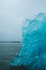 Iceberg in dark waters in Alaska