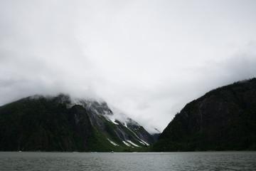 Foggy valley between green hills on coastline