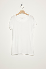 shirts with wood hanger isolated white.