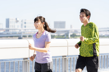 young asian couple jogging