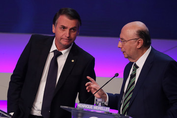 Presidential candidate Henrique Meirelles of the Brazilian Democratic Movement (MDB) reacts next to candidate Jair Bolsonaro of the Party for Socialism and Liberation (PSL) during first televised debate in Sao Paulo