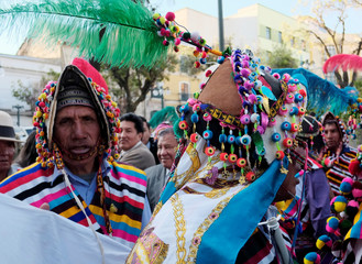"Bolivian indigenous people attend to the inauguration of the new Bolivia's presidential palace named ""La Casa Grande del Pueblo"" in La Paz"