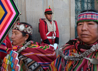 """A member of presidential guard is seen before the inauguration of the new Bolivia's presidential palace named """"La Casa Grande del Pueblo"""" in La Paz"""