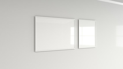 Blank white poster in white frame on the wall