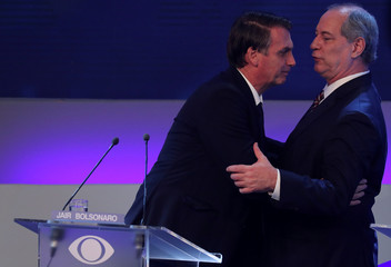 Presidential candidate Jair Bolsonaro of the Party for Socialism and Liberation (PSL) talks with Ciro Gomes of the Democratic Labour party (PDT) before their first televised debate in Sao Paulo