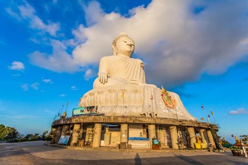 Phuket big Buddha in blue sky. locate of Phuket big Buddha viewpoint on the high mountain can see around Phuket island.stuning sunrise in Chalong gulf