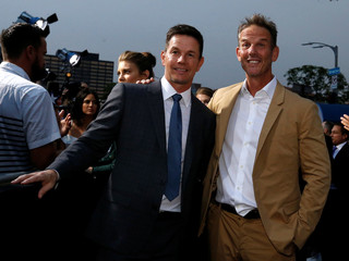 "Cast member Wahlberg and director of the movie Berg pose at the premiere for ""Mile 22"" in Los Angeles"