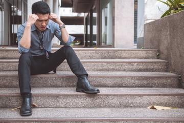 Unemployed man sitting on the street
