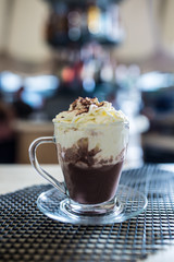 Cup with a hot chocolate and whipped cream.