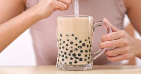 Woman drink of iced bubble milk tea