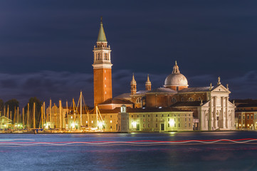 Venice city at night. long exposure with light trails from boat