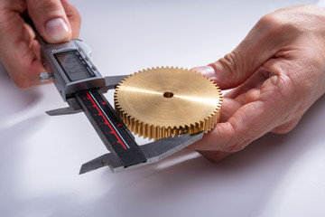 Person Measuring Gear's Size With Digital Caliper