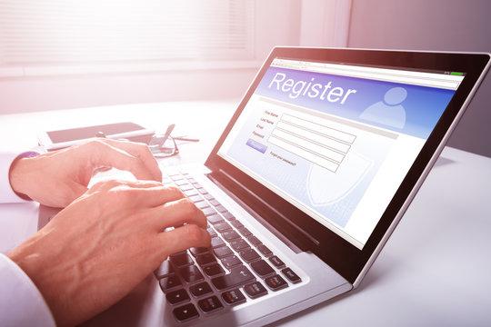 Businessman Filling Online Registration Form