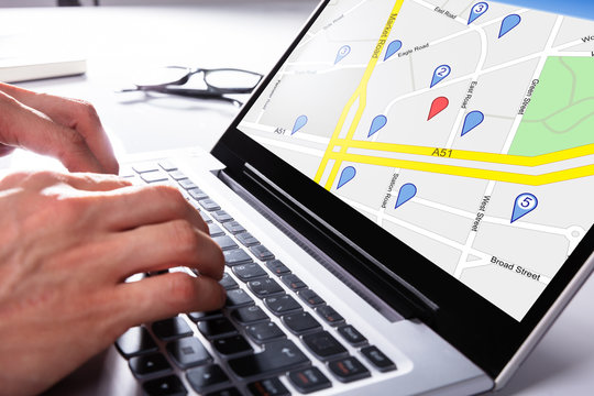Person Using Gps Map On Laptop