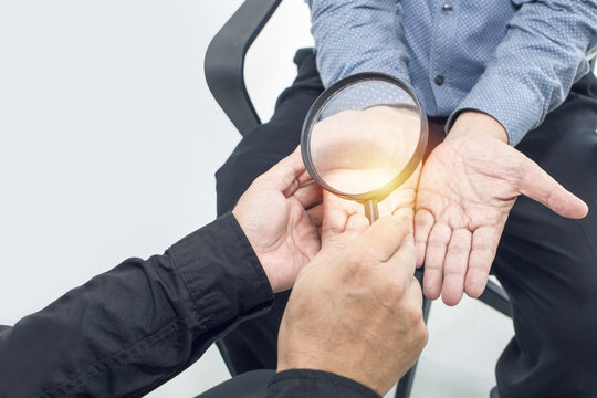 Hand holding to magnifying glass on white background.Life plane for future.Copy space.