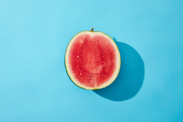 top view of fresh ripe sweet halved watermelon on blue
