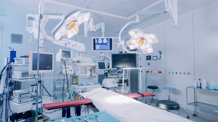 Establishing Shot of Technologically Advanced Operating Room with No People, Ready for Surgery. Real Modern Operating TheaterWith Working equipment,  Lights and Computers Ready for Surgeons