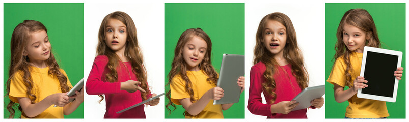 Collage about beautiful girl with laptop. Little funny girl with tablet on green studio background. She showing something and pointing at screen.