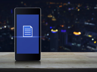 Document icon on modern smart mobile phone screen on wooden table over blur colorful night light city tower and skyscraper, Technology internet communication concept