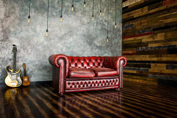 The divan is an honor of burgundy color in the interior. Fotomurales