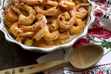 Shrimps baked with spicy sauce and spices and butter - an excellent seafood dish