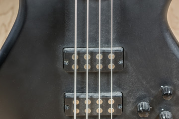 Black bass guitar with a lot of dust