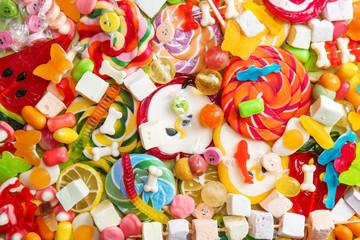Poster de jardin Confiserie Delicious lollipops and sweets as background
