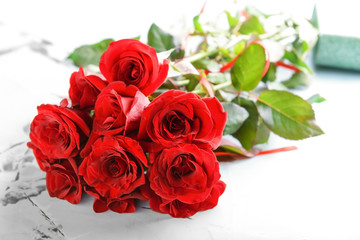 Beautiful bouquet of red roses on table