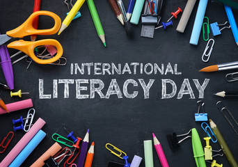 International Literacy Day. School Stationary Top View on Blackboard