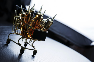 Many brown ampoules set in cart