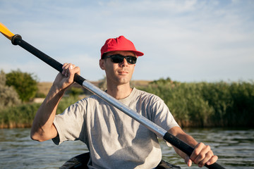 A young man on a kayak. Water sports.