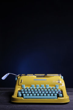 Old yellow typewriter machine