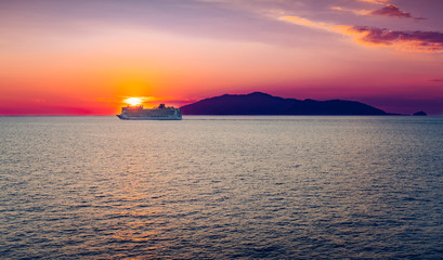 Cruise ship at sunset. Gulf of Naples, Italy