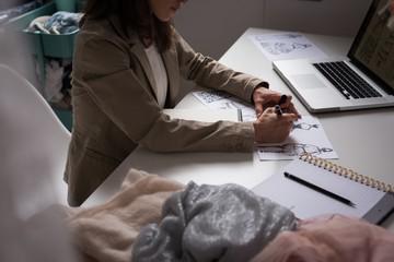 Fashion designers making sketches in the design studio
