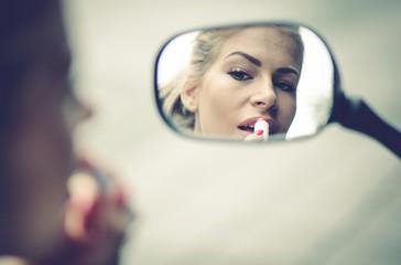 Close up photo beauty women at bike mirror.