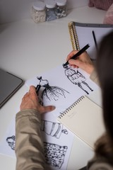 Fashion designers making sketches in the design studio