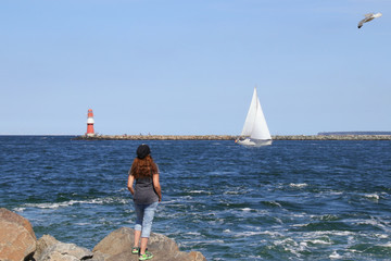 Warnemünde, view to sailboat and lighthouse