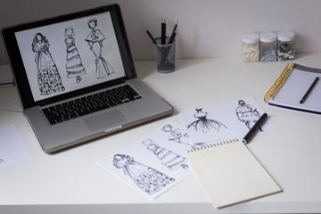 Sketches of design on table
