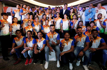 Members of the Indian contingent, participating in the 2018 Asian Games, pose for a picture during a send-off ceremony in New Delhi