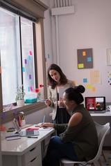 Fashion designers talking in design studio