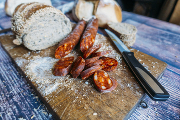 Exhibition of chorizo and sausage with a piece of bread.