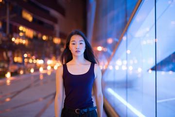 Portrait Of Beautiful Asian Woman Walking Outdoors At Night