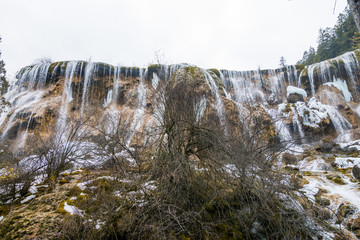 Waterfall from a cliff in the forest