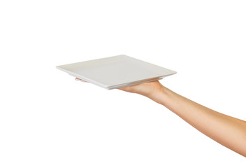 Blank white square matte plate in female hand. perspective view, isolated on white background